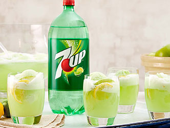 mixed drink made with 7up, apples and fizz