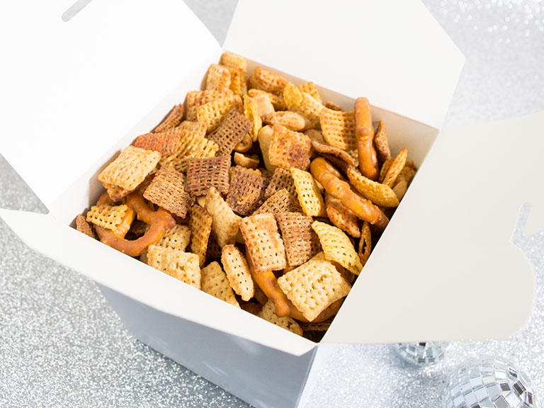Chex mix in a festive holiday box