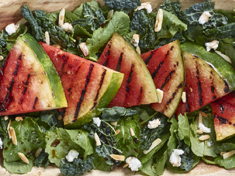 Grilled watermelon on kale