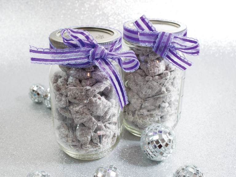 Chex mix in a mason jar for gift giving decorate with a bow