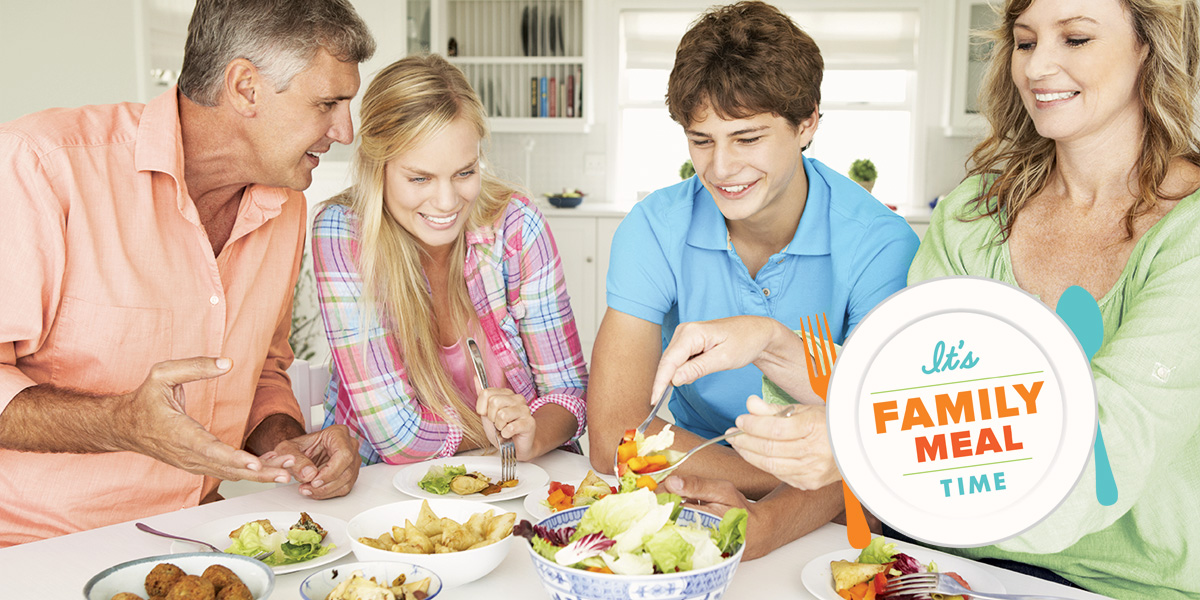 A family enjoys a healthy meal together during Family Meals Month.