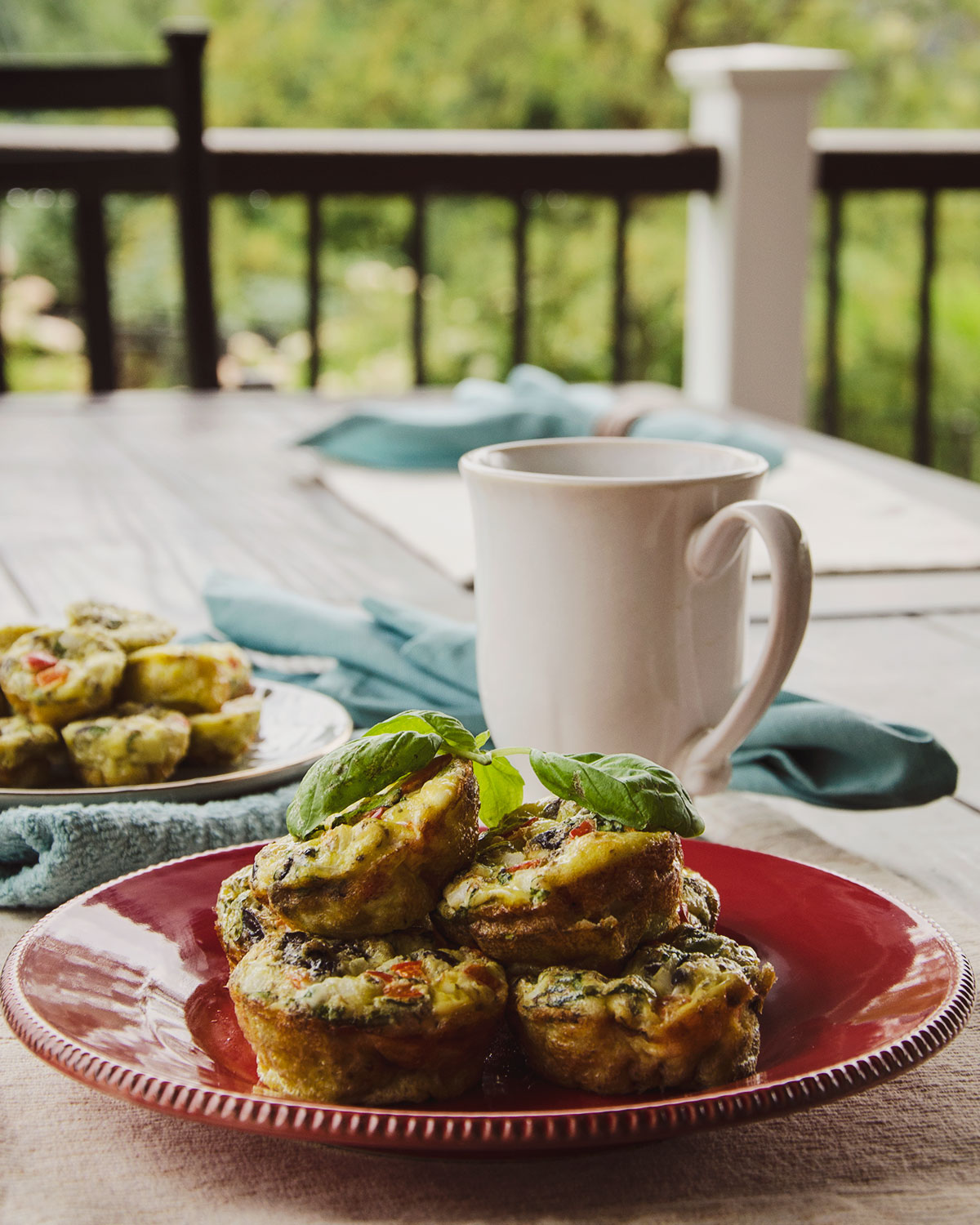 A warm and fragrant aroma surrounds this plate of Mediterranean Scrambled Egg Muffins.