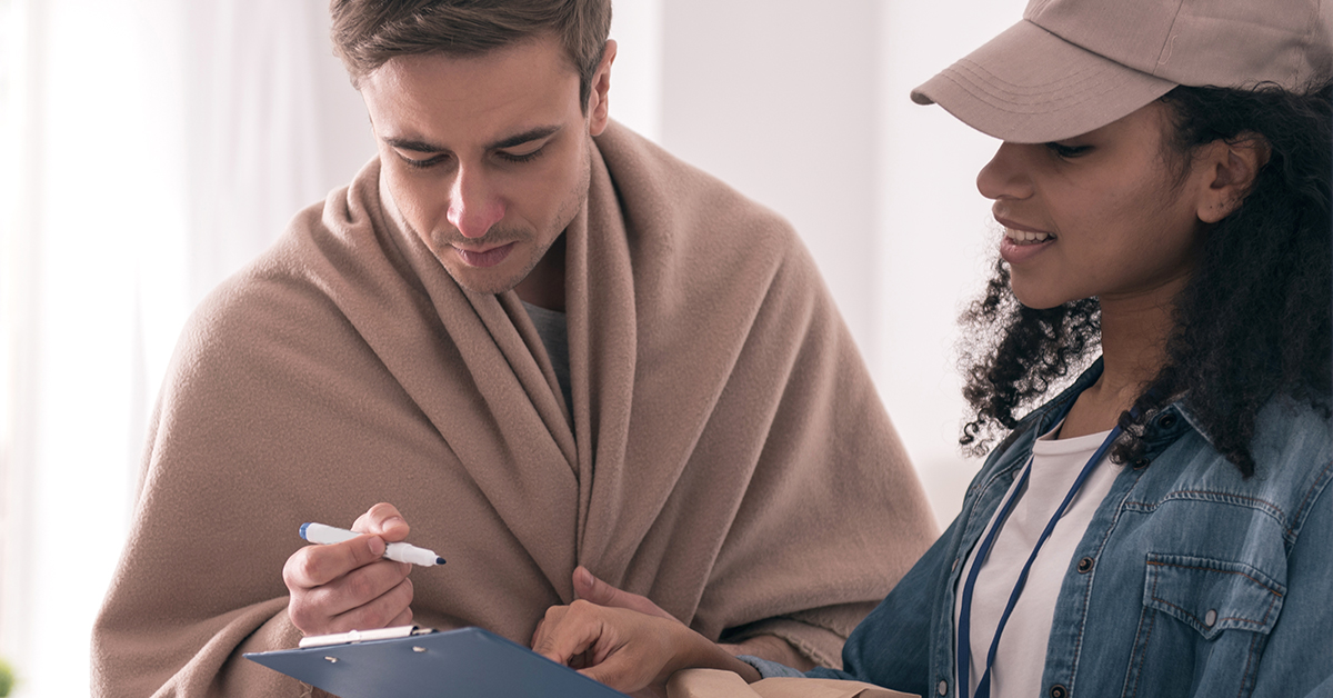 woman delivery prescription to man at home with a cold