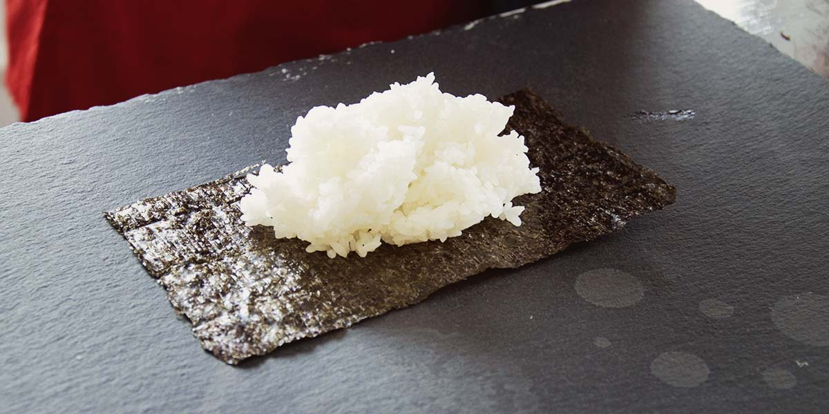 rice is placed on a Nori sheet.